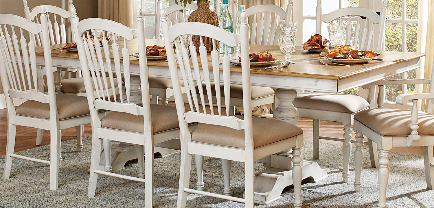 Homelegance hollyhock trestle pedestal dining set for Distressed white dining table
